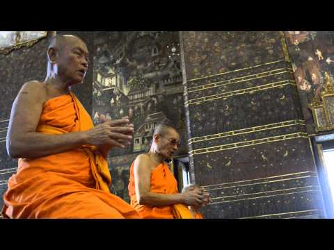 Bangkok monks praying at Wat Pho