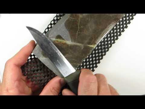 Mora knife sharpening on natural stone