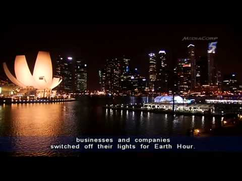 "Singapore's skyline plunges into darkness for ""Earth Hour"" - 23Mar2013"