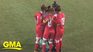 Opponents huddle around soccer player so she can fix her hijab l GMA Digital