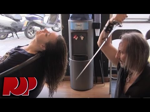 Stylist Cuts Hair With Sword