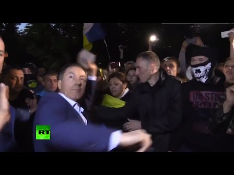 RAW: Mob forces Ukraine MP to throw stone at Russian embassy, spray paint him