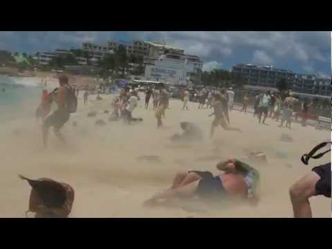 jet blasted at Maho Beach, St Maarten, Caribbean, 11th April 2012 as Inselair plane takeoff from Princess Juliana Airport (SXM). Watch near the end to see a ...
