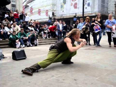Best ! !! Street performer with glass orb, on Wedding day of Prince William,  Piccadilly Circus