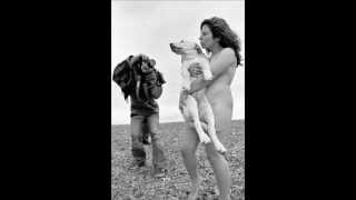 naked woman holding a dog