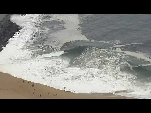 Surfers hit big waves at the Wedge in Newport Beach