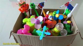 box full of fan propeller toys