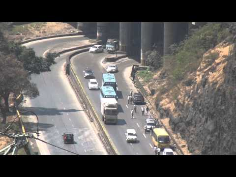 Aerial View Of Volvo Buses Overtaking Vehicles At Mumbai Pune Expressway video