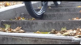 Riding up and down stairs on a Jones Plus bicycle,  with slow motion replay.