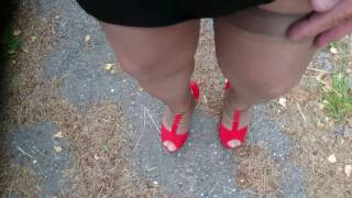 Tan stockings and red high heels outdoor