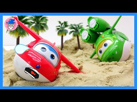 ROBOCAR POLI falling on the sand. sand play for kids. car toys and AMBER rescue mission clip.
