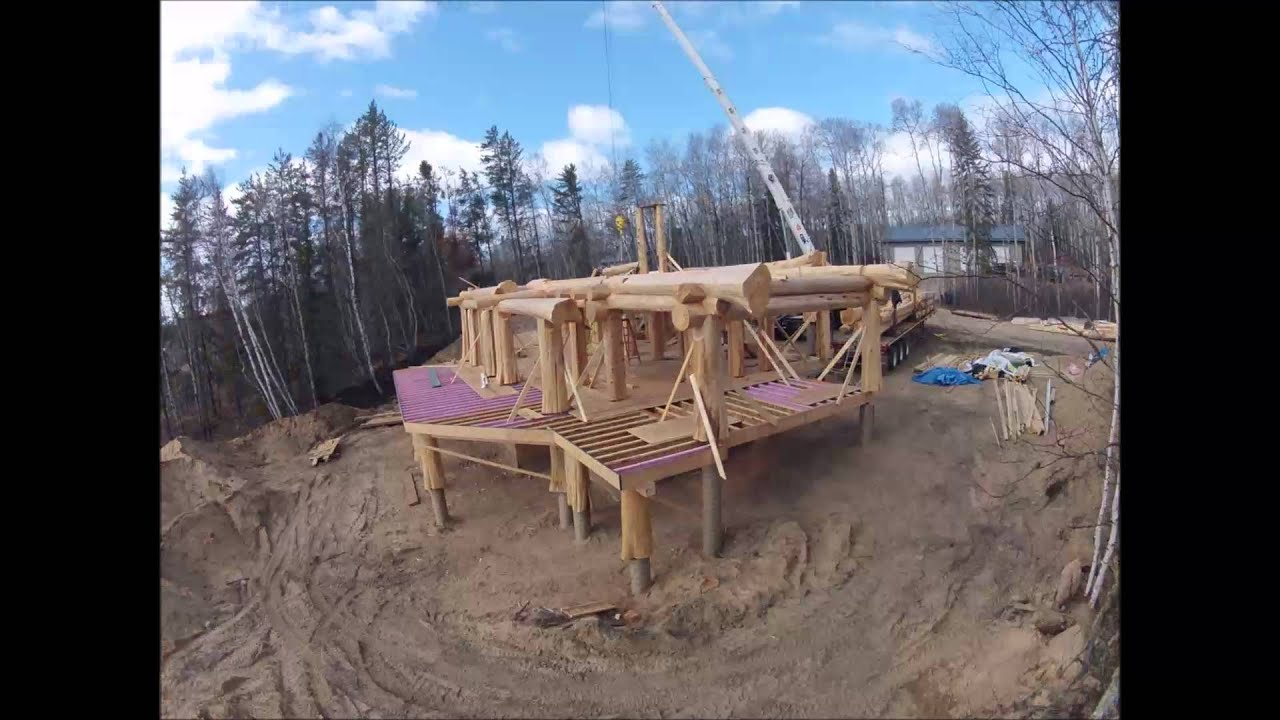 Log homes post and beam construction time laps youtube for Lake house construction
