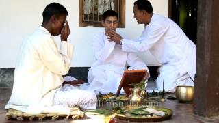 Priest performing puja before Bor Jatra, Manipur wedding