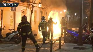 Street riot tears through Madrid neighbourhood following death of street vendor