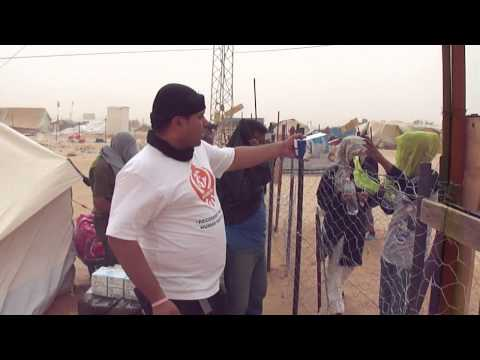 Distribution of emergency aid at the Libyan border to refugees