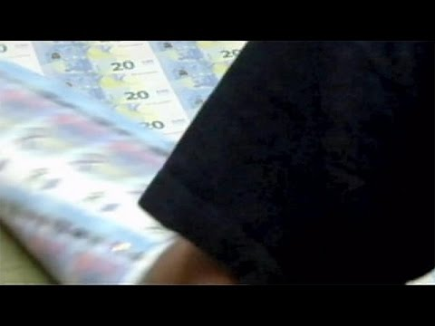 EU executive cuts growth forecast for eurozone