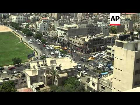 Hamas and the Israeli Defence Force on the humanitarian ceasefire; Gaza traffic and skyline