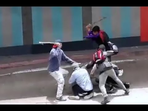 Venezuelan protesters beat female officer with clubs in chilling video