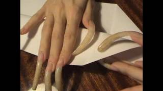 Long nails doing paper airplane