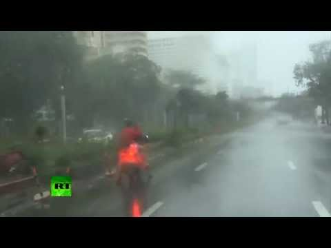 RAW: Uprooted trees, power poles & ripped off roofs as typhoon slams Philippines