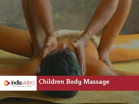 Oil massage kathakali training students children body massage Kerala India