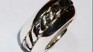 Silver ring handmade with central spiral pattern