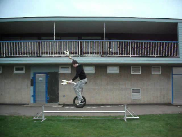 Unicycle on a Tightrope Juggling 5 clubs
