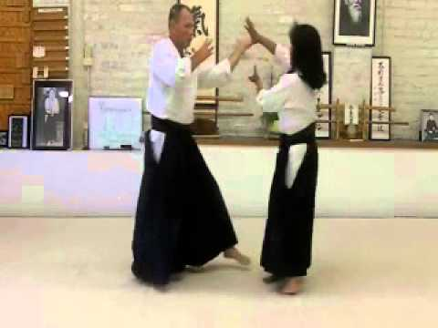 Receiving Yokomen Strike-Aikido Technique-Iwama-Ginny Breeland Image 1