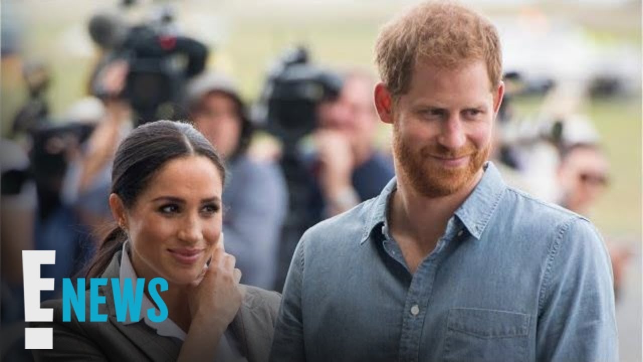 Meghan Markle Sweetly Holds Prince Harry's Umbrella | E! News