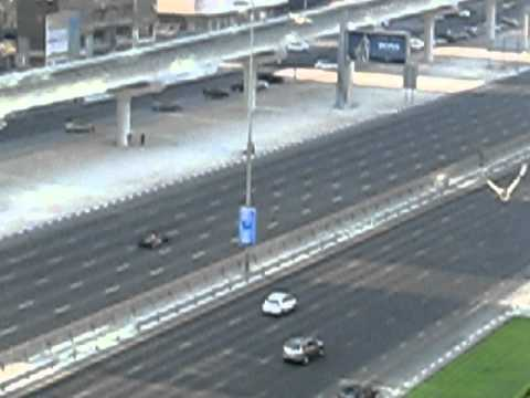 Red Bull F1 Car racing on Dubai highway