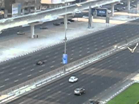 Red Bull F1 Car racing on Dubai highway