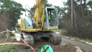 New Holland Kobelco E 150 excavator used in fiber cable trenching outside Visby November 2016