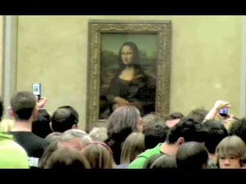 Admiring Mona Lisa by Leonardo da Vinci, Louvre Museum Paris, France, May 22nd, 2009