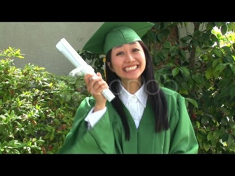 Young Asian Woman In Graduation Gown With Boyfriend Outside. Stock Footage
