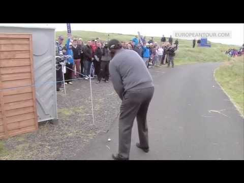 Phil Mickelson hits off a cart path to make birdie at the Scottish Open