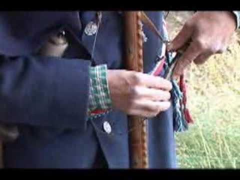 A demonstration of an American flintlock long rifle.