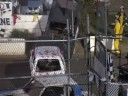 Demo derby car climbs wall