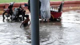 Cambodian Kids Swimming in the Monsoon