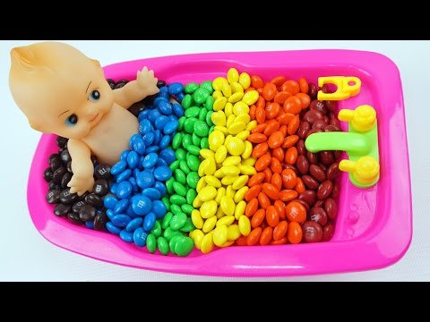 Learn Colors Baby Doll Bath Time with M&M's Chocolate kids videos for toddlers