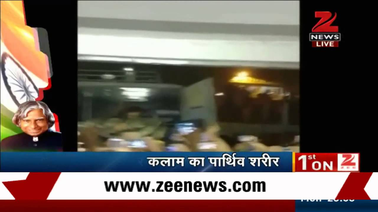 Grief stricken people shout slogans as Kalam's body carrier out of hospital