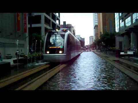 Trams Gliding Across Water in Houston, Texas, USA