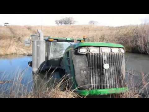 BIG TRACTORS STUCK IN MUD