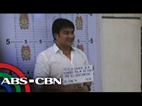 Bong Revilla smiles for mugshots
