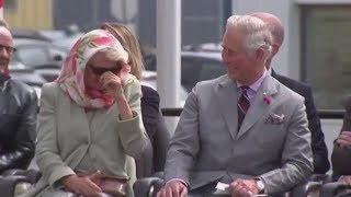 Charles and Camilla Laughing As They Struggle With Giggles