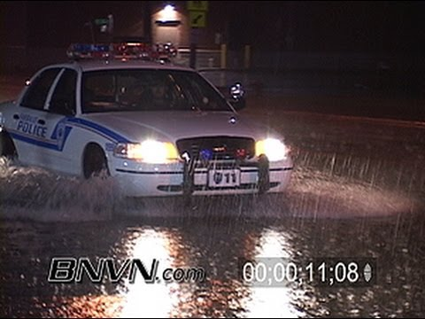 7/21/2004 Video of police and traffic driving through flooded roads