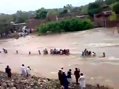 Pakistan Flood 2010 People being swept away by flood footage