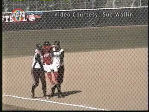 Softball player carried around bases by opponents Video