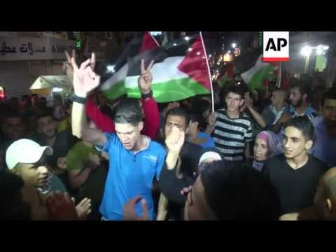 Palestinians in West Bank march in protest at Gaza bombardment