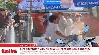 CSGT Vĩnh Long phát nước miễn phí cho người đi đường bị rượt đuổi