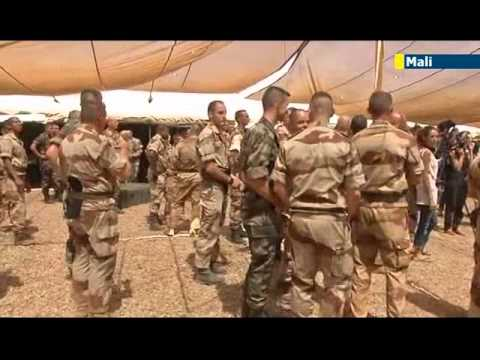French Defence Minister Jean-Yves Le Drian makes surprise visit to French army in Mali
